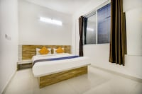 SPOT ON 74516 Hotel Ambience INN