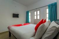 Capital O 10169 Santiago Beach Resort 2 Deluxe