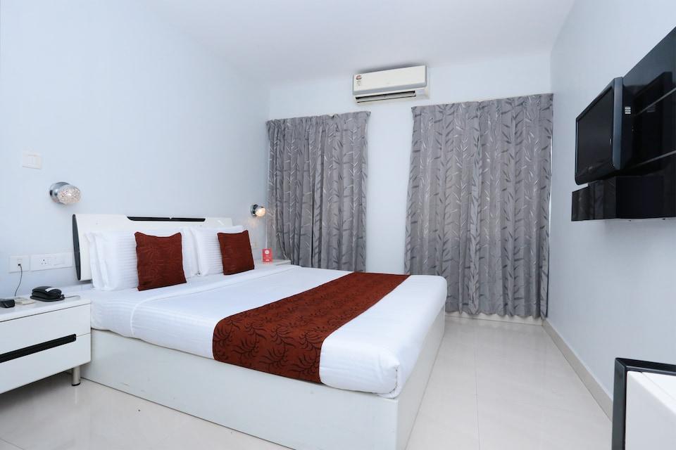 Capital O 10611 Hotel Malabar Illam