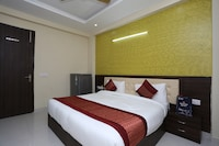 OYO 12081 Palm Garden Suites
