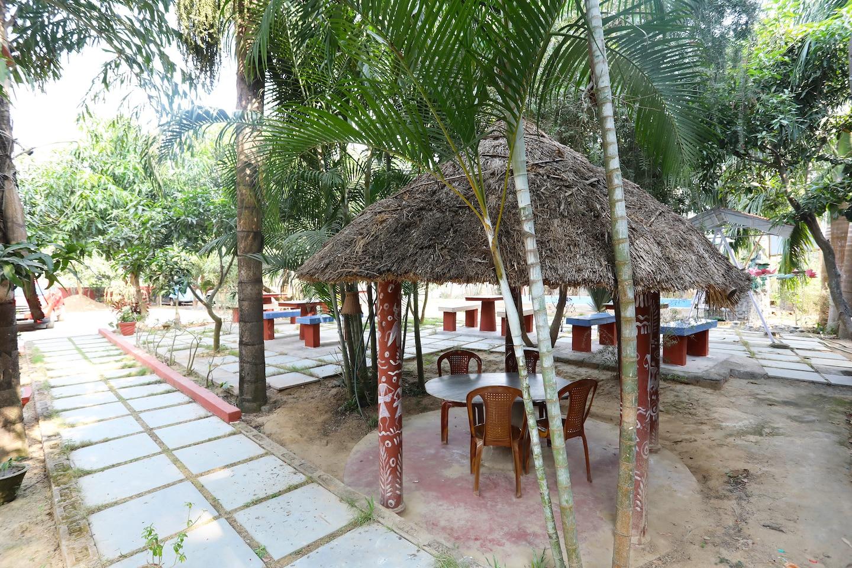 Oyo 24781 rangamati garden resort shantiniketan shantiniketan hotel reviews photos offers for Resorts in santiniketan with swimming pool