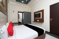 Capital O 27911 Woodland Garden Suites Suite
