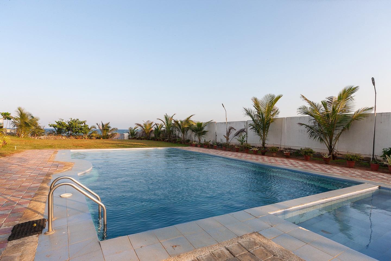 Capital O 30679 Joe Beach Resort -1
