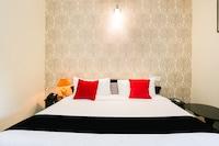 Capital O 47329 Pooram Residency Deluxe