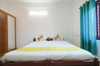OYO Home 47563 Spacious Vattekad Apartments 1BHK