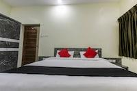 Capital O 48497 Raksha Grand