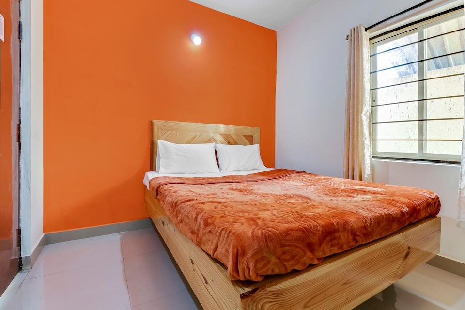 SPOT ON 49485 Nandhana Rooms