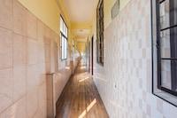 OYO 64792 Malabar Tourist Home
