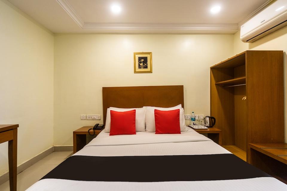 Capital O 64938 Pearl Hotel