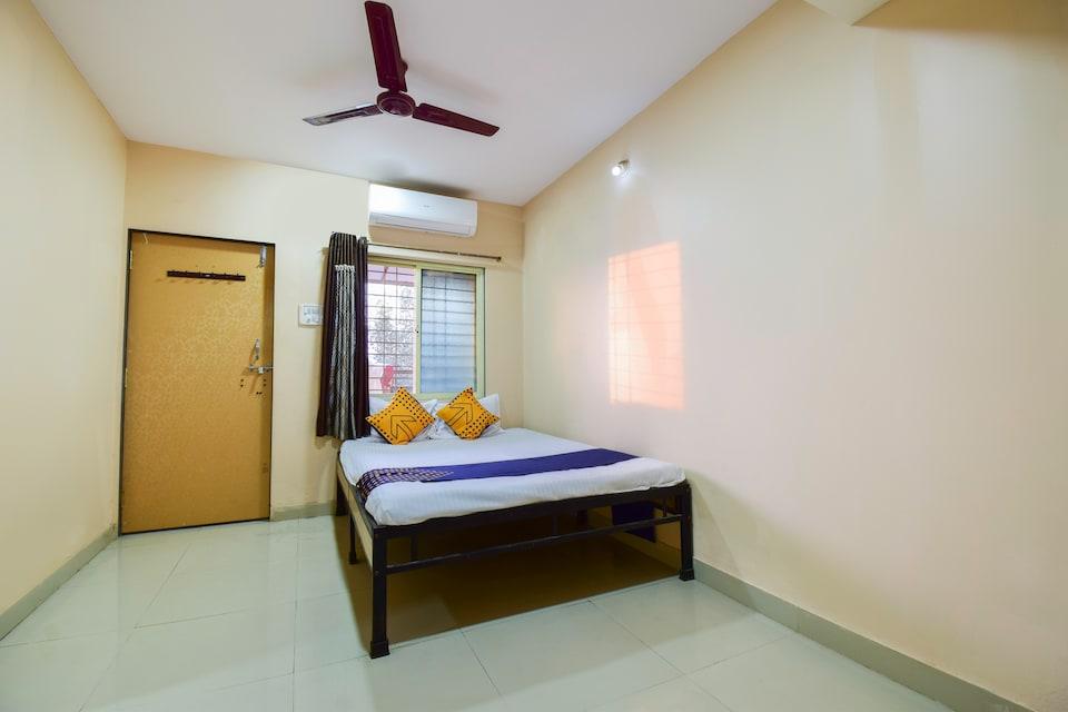SPOT ON 66458 Hotel Vighnaghar Lodge