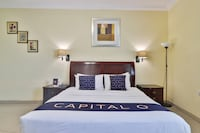 Capital O 401 Crown Palace Hotel