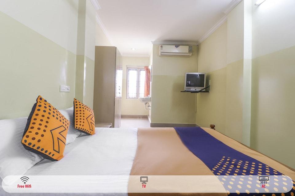 SPOT ON 67449 Dhiya Tourist Home