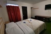Capital O Baja Place Inn